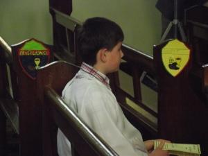 Dylan Praying before Mass