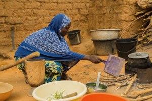 Mariama preparing dinner at home
