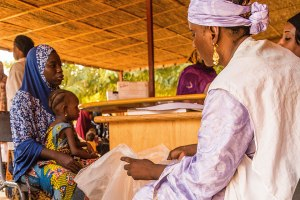 Mariama receiving 'plumpy nut' at the health clinic