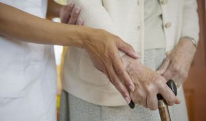 A hand helping the aged