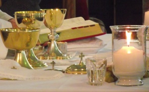 Sacred vessels & Hosts on altar - Cropped